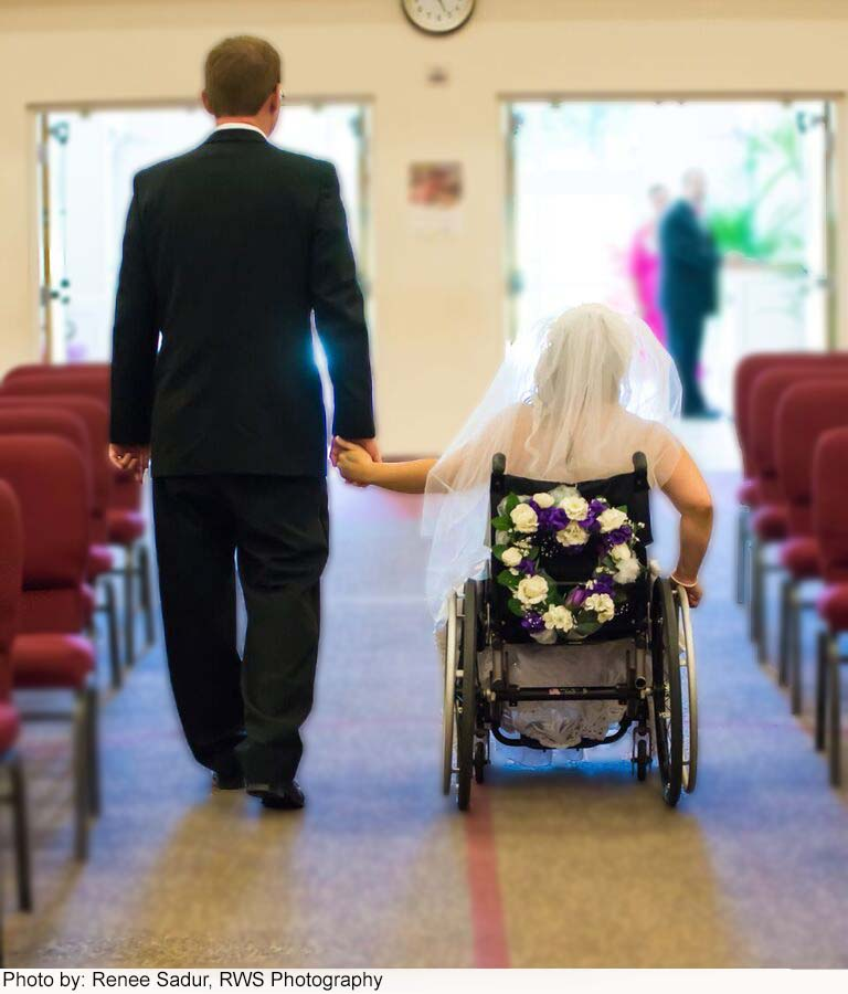 groom and bride walking away.