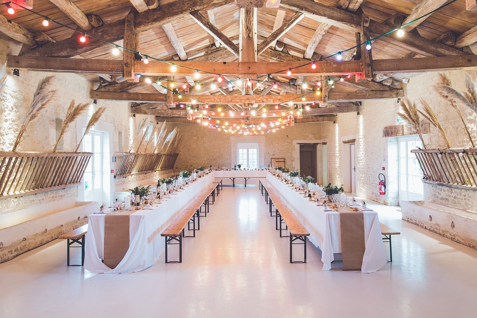 large barn space with rows of tables.