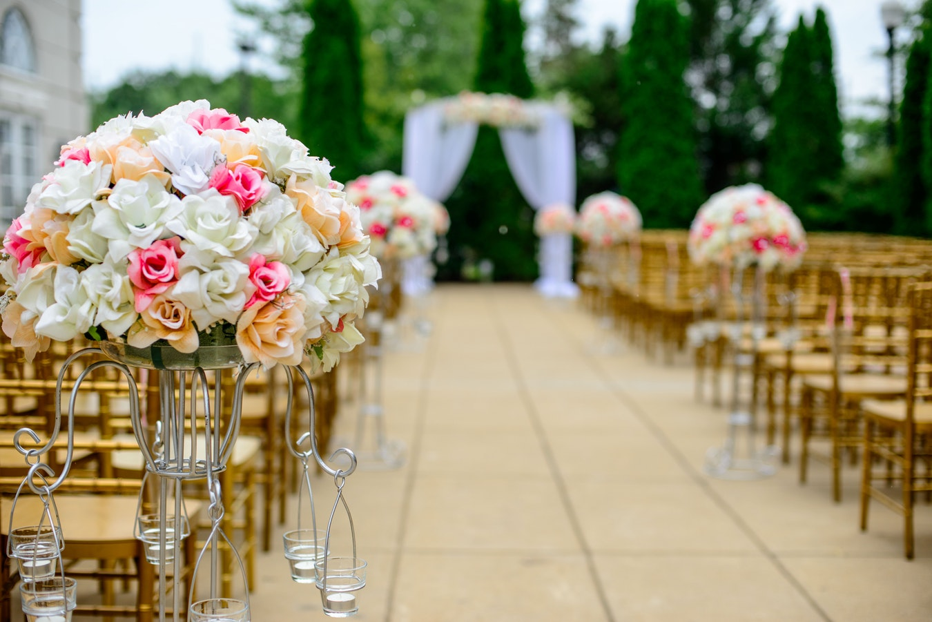 wedding aisle with chairs and flowers.