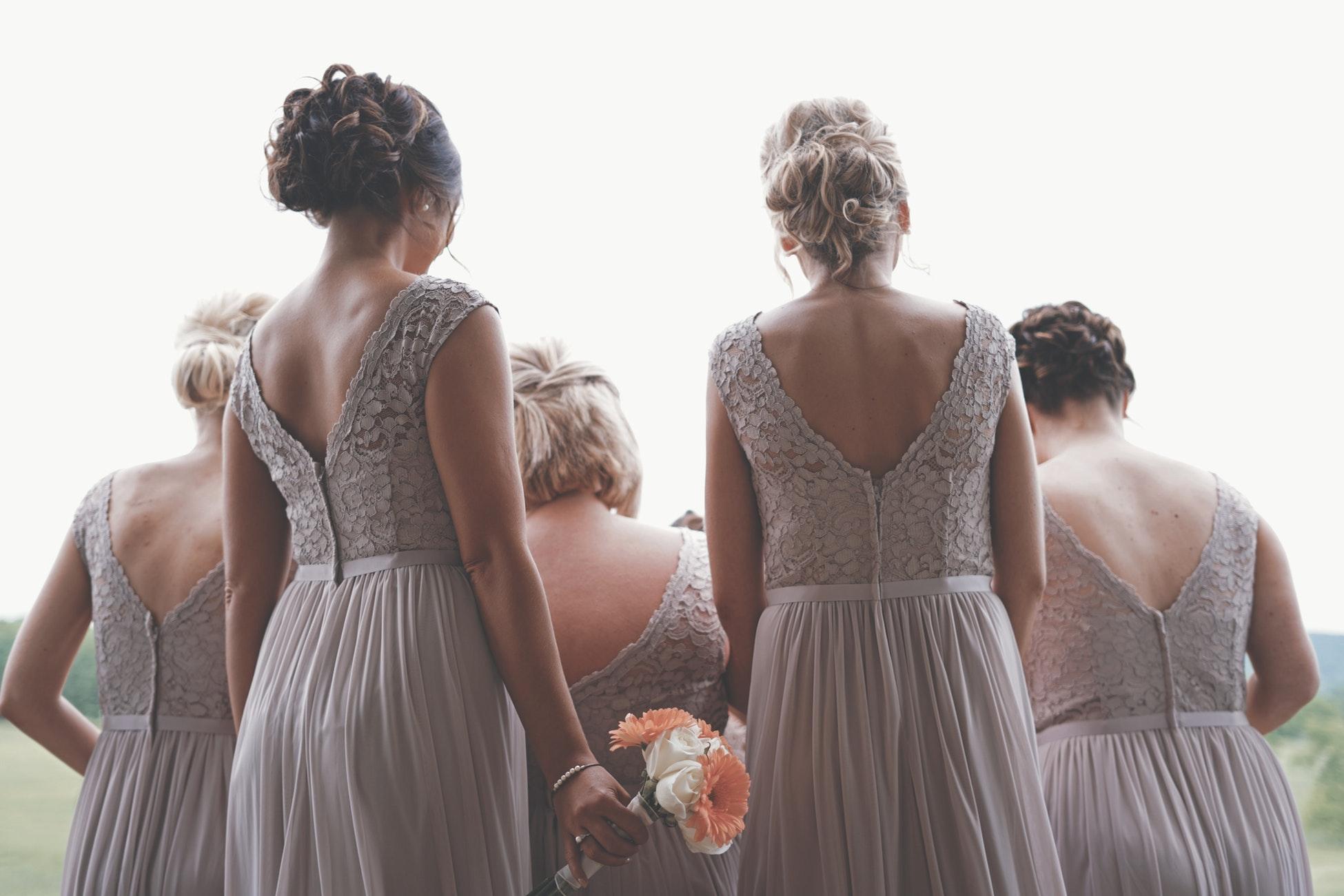 bridesmaids in tan dresses.