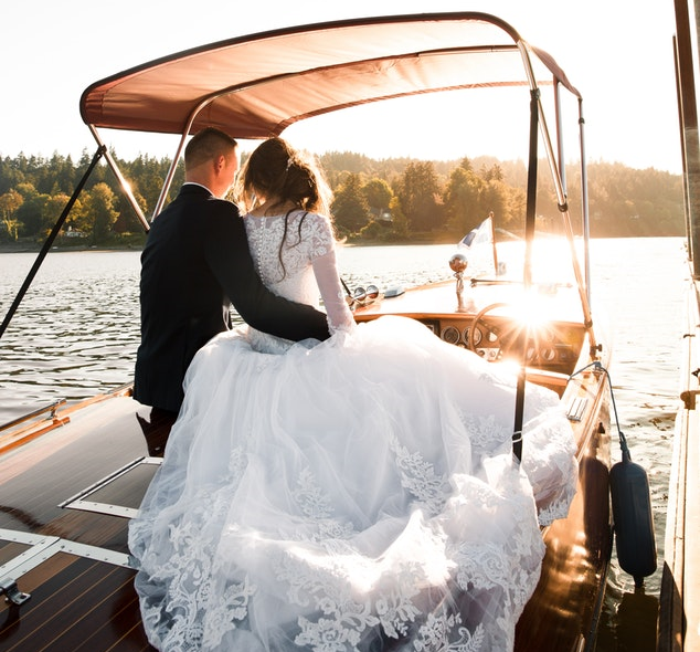 bride and groom on boat.