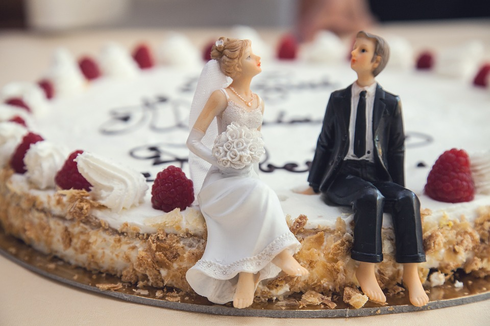 wedding pie with bride and groom mini statues.